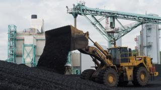 A front-end loader dumps coal at the East Kentucky Power Co-operative's John Sherman Cooper power station near Somerset, Kentucky, (April 19, 2017)