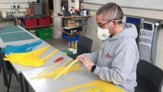 Stuart Sweetman making the masks