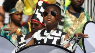 Child performing at Carnival