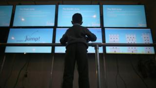 Child at a massive screen