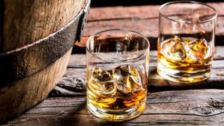 Whisky glasses and barrel