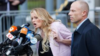 Stormy Daniels, seen here with her lawyer Michael Avenatti, outside a federal court in Manhattan talking to reporters