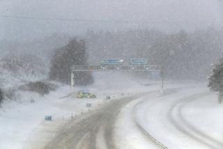 A police car in the snow on the M876 to Glasgow