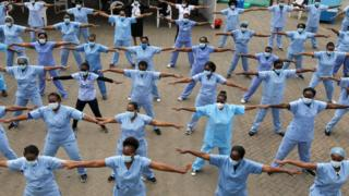 Nurses take part in an aerobic fitness session