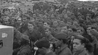In March 1944 Denis Johnston, BBC War Correpondent visited Yugoslavian Partisans on an island off the coast of Yugoslavia. Recordings were made of a march past nad of songs and speeches.Partisans listening to playback of their march past recordings. Copyright BBC