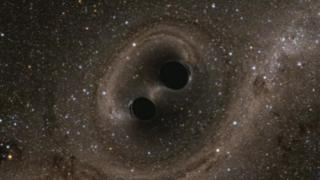 "Artists impression of two black holes locked in a ""death spiral"""