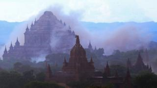 A temple is seen shrouded in dust as a 6.8 magnitude earthquake hit Bagan, 24 August 2016.