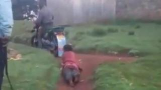 Woman being dragged on a morotbike
