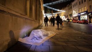 Life-sized sleeping person glass sculpture by Luke Jerram