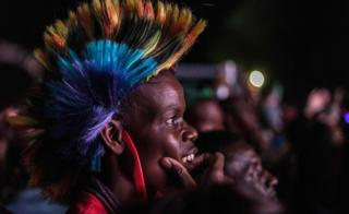 Someone in a Mohican watching New Year's Eve celebrations in Victoria Falls, Zimbabwe - Monday 1 January 2018