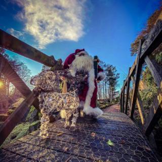 Santa crossing a bridge