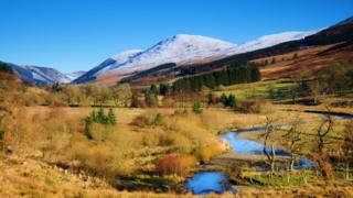 A snowcapped Bodesbeck Law in Moffat Water Valley