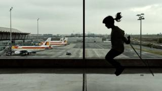 A girl jumps rope at the terminal 4 of Madrid Barajas airport on December 11, 2011 in Madrid
