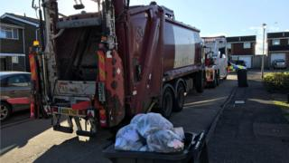 Bin lorry being towed away