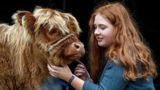 Laura Hunter (18) from Barnhill Farm, Shotts with a Highland calf