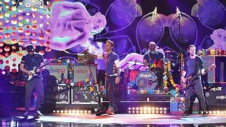 Coldplay perform at the American Music Awards in Los Angeles on 22 November