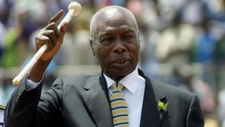In this file photo taken on October 09, 2001 Kenyan president, Daniel Arap Moi, waves to the crowd while he enters in the National Stadium to celebrates Moi day in Nairobi Kenya 10 October, 2001.