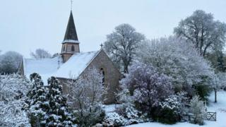 Snow covering a church