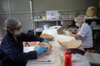 Researchers clean artefacts found amid the debris