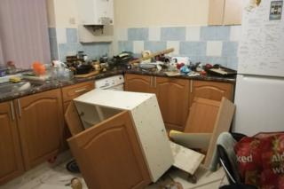 Kitchen unit having fallen off a wall in a HMO