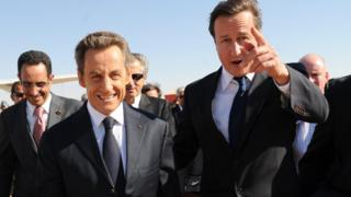 Former French president Nicolas Sarkozy and David Cameron arrive at Benghazi airport in 2011