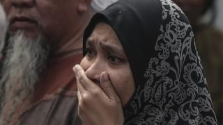 Relative of a boy who died cries outside the school