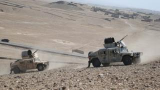 Afghan security officials patrol during an operation against suspected militants, in Chaparhar district of Nangarhar province, Afghanistan, 09 July 2019