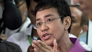 CEO of Philippine news website Rappler, Maria Ressa, gestures as she speaks to the media