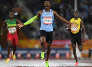 Botswanas Isaac Makwala(C) reacts as he crosses the finish line to win the athletics men's 400m final during the 2018 Gold Coast Commonwealth Games at the Carrara Stadium on the Gold Coast on April 10, 2018.