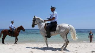 Police patrolling beach near scene of 26 June attack