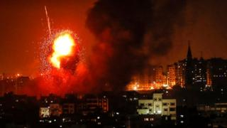 A picture taken on August 8, 2018 shows a fireball exploding during Israeli air strikes in Gaza City.