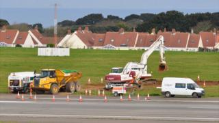 PFOS-contaminated soil being removed from next to Guernsey Airport runway, where a fire engine overturned
