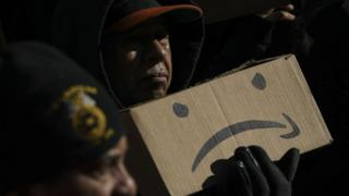 Protestors rally against Amazon and the company's plans to move their second headquarters to the Long Island City neighborhood of Queens, at New York City Hall, January 30, 2019 in New York City.