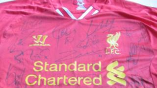 Liverpool FC shirt claimed to have been signed by squad