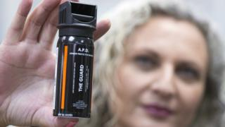 File image of a woman holding a can of pepper spray