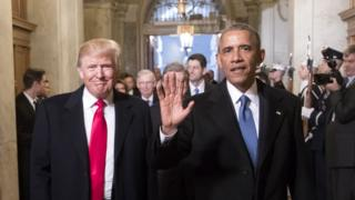 Former US President Barack Obama (R) with President Donald Trump