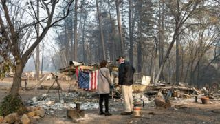 President Donald Trump surveys the damage with Jody Jones, the Mayor of a destroyed town called Paradise in California