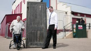 Joyce Dowding and Neil Bates with the original Larry Grayson door at The Regent in Redcar