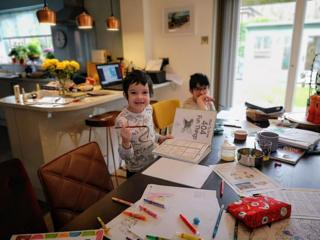 Two boys working at home