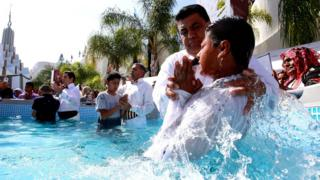 Followers of the Mexican-based Pentecostal church Light of the World, participate in a baptism ceremony in Guadalajara