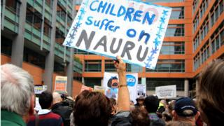 Activists hold placards and chant slogans as they protest outside the offices of the Australian Immigration Department in Sydney, Australia, in this file picture taken February 4, 2016.
