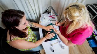 Jordan Lamb applying false nails, Salisbury, Wilts