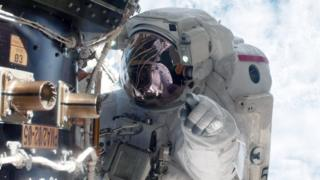 science NASA astronaut Mike Fossum carries out maintenance during a space walk at the International Space Station