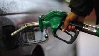 A driver fills their car with petrol