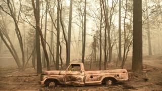A burnt out truck is seen in Paradise, California after the Camp fire tore through the area on November 10, 2018