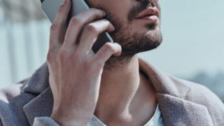 An anonymous man on the phone