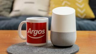 Argos mug next to a smart speaker