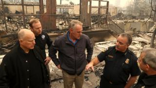 California Governor Jerry Brown, FEMA Administrator Brock Long and U.S. Secretary of the Interior Ryan Zinke speak to local police in burned out school