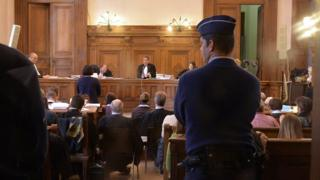 People attend the trial against members of the Church of Scientology in Belgium