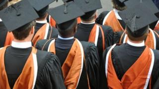 University students wey wear graduation gown and cap